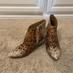 Leopard print leather booties.